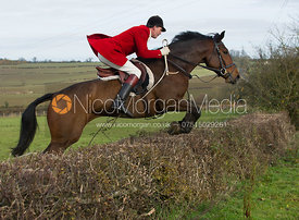 Ashley Bealby jumping a hedge at Town Farm