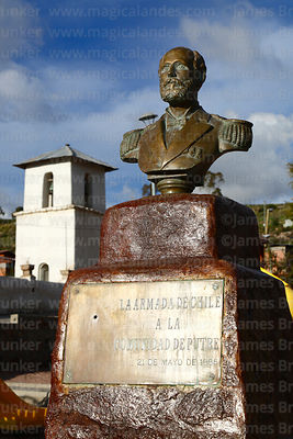 Statue of General Arturo Prat in main square and San Ildefonso church belfry, Putre, Region XV, Chile