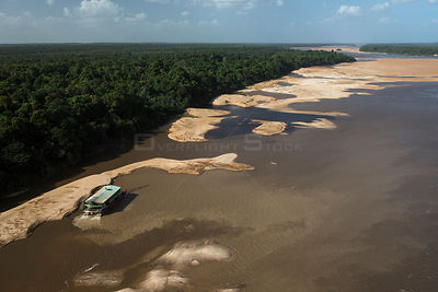 Gold dredger on Essequibo river, the longest river in Guyana, South America