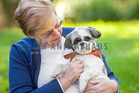 senior woman holding dog