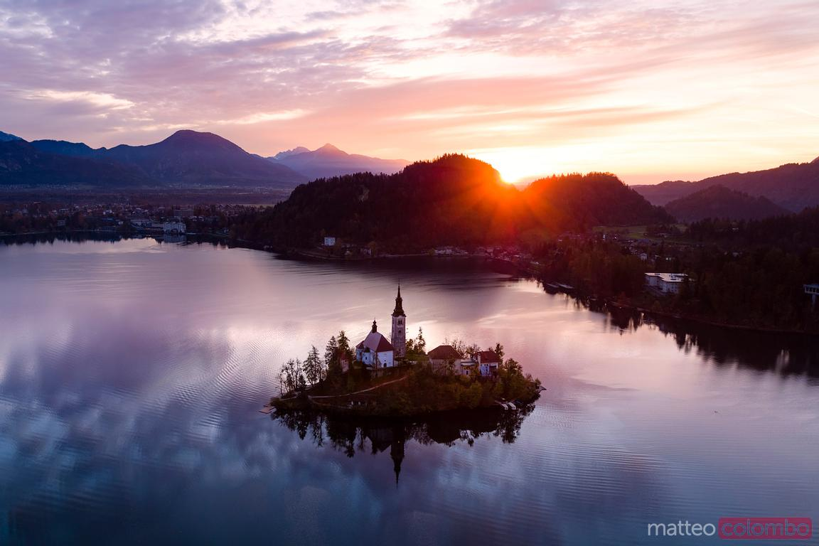 Aerial of Bled lake at sunrise, Slovenia