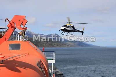 Expedition Aerospatiale helicopter LV-CUS about to land on cruise vessel Ortelius (Oceanwide Expeditions), Beagle Channel, Ti...