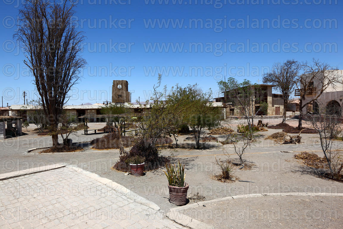 View across main square in abandoned nitrate mining town of Humberstone, Region I, Chile