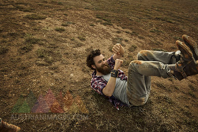 Man with full beard lying on soil