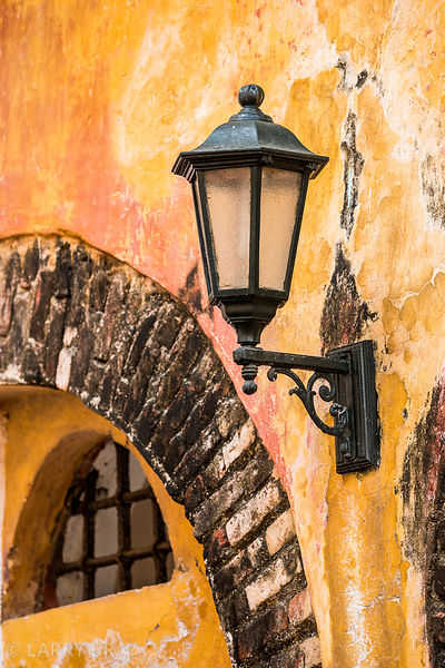 Street lamp on rough yellow wall in Cartagena, Colombia, South America