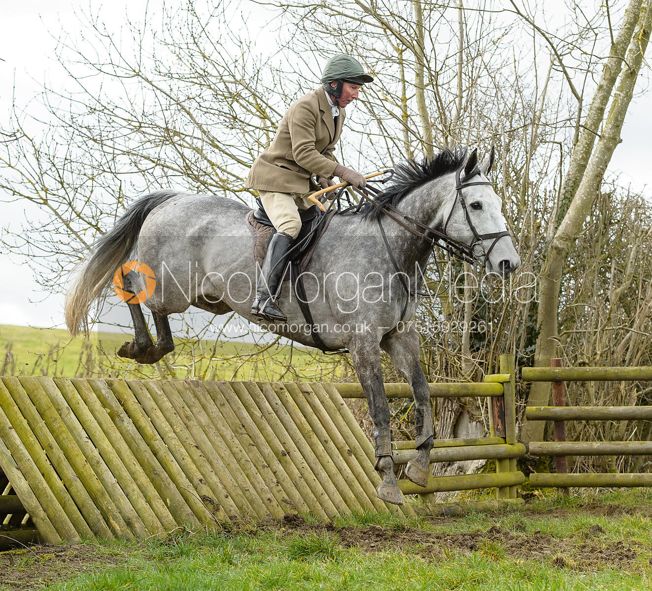 Stuart Campbell jumping a fence at Peake's Covert