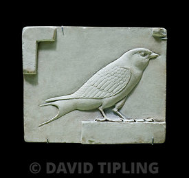 Sculpture from ancient egypt showing the swallow as a symbol of everlasting life and as a votive offering