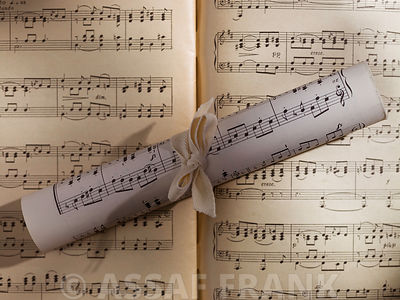 Scrolls of sheet music on musical notes book
