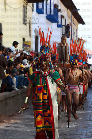 Amazonian warriors parade with a mummy during processions for Inti Raymi festival, Cusco, Peru