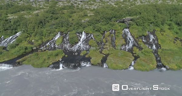 Flying Over Hraunfoss Lava Spring Waterfall Glacial River Iceland Drone Aerial Slide 4k