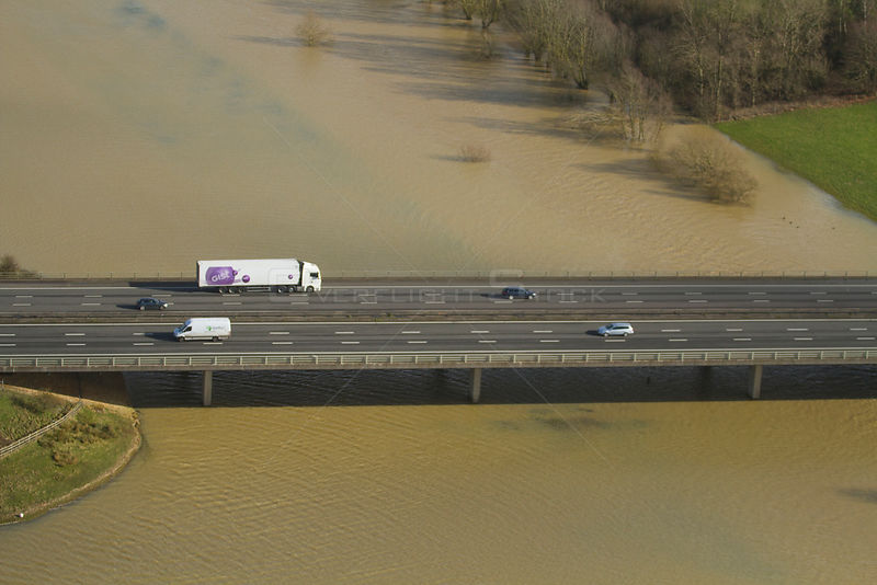 Aerial view of floods surrounding M50 motorway with bridge over River Severn, during February 2014 flooding Worcestershire, E...