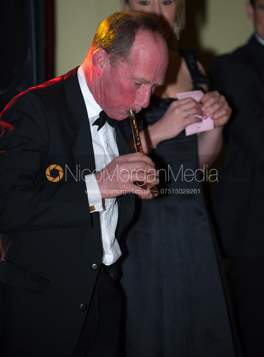 David Manning blowing a hunting horn