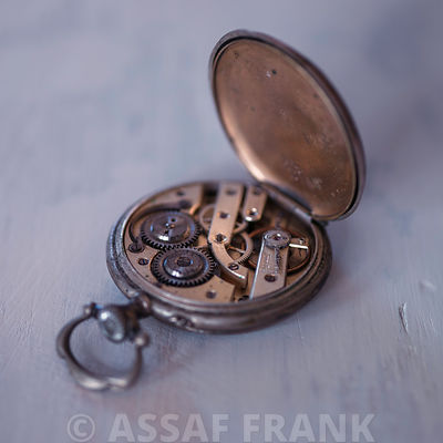 Open pocket watch showing the cogs