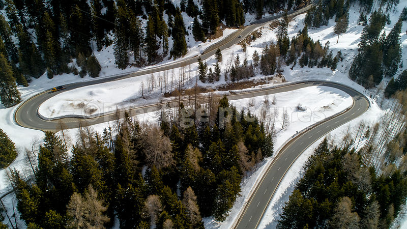 Aerial shot of two sharp bends on the Maloja Pass in Switzerland
