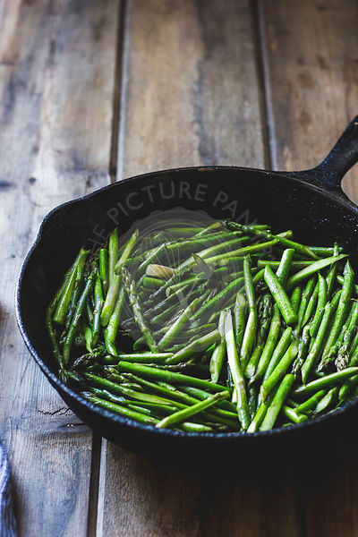 Asparagus spears in a frying pan