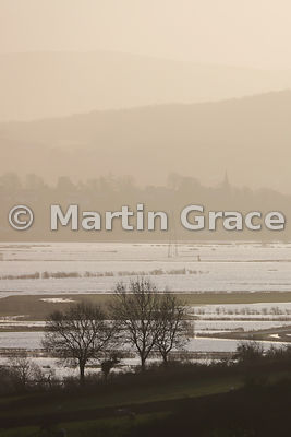 Dismal-looking flooded Lyth Valley in early morning December murk, England