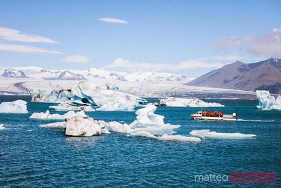 Tourist boat at Jokulsarlon in summer, south Iceland