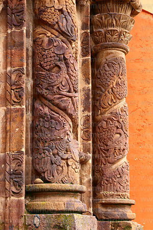 Detail of lion, bird and grape carvings on pillars of main side entrance facade of St John the Baptist of Letrán / San Juan B...