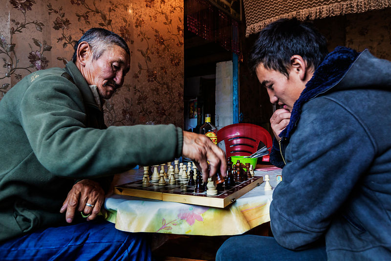 Local Family Playing Chess