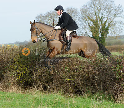 Tim Clarke jumping a hedge near Haddon
