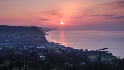Spring hazy sunrise view over the picturesque seaside town of Sidmouth, Devon, UK