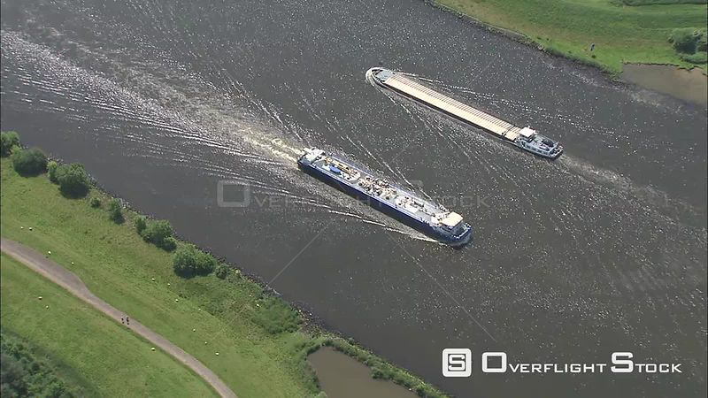 Barges passing on a canal in Zeeland, The Netherlands