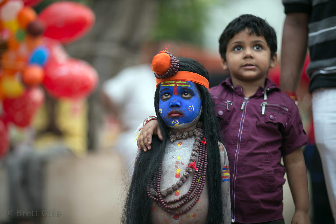 A middle class Indian boy poses with a dalit boy dressed as Shiva to pose for photos with tourists during the Pushkar Camel F...