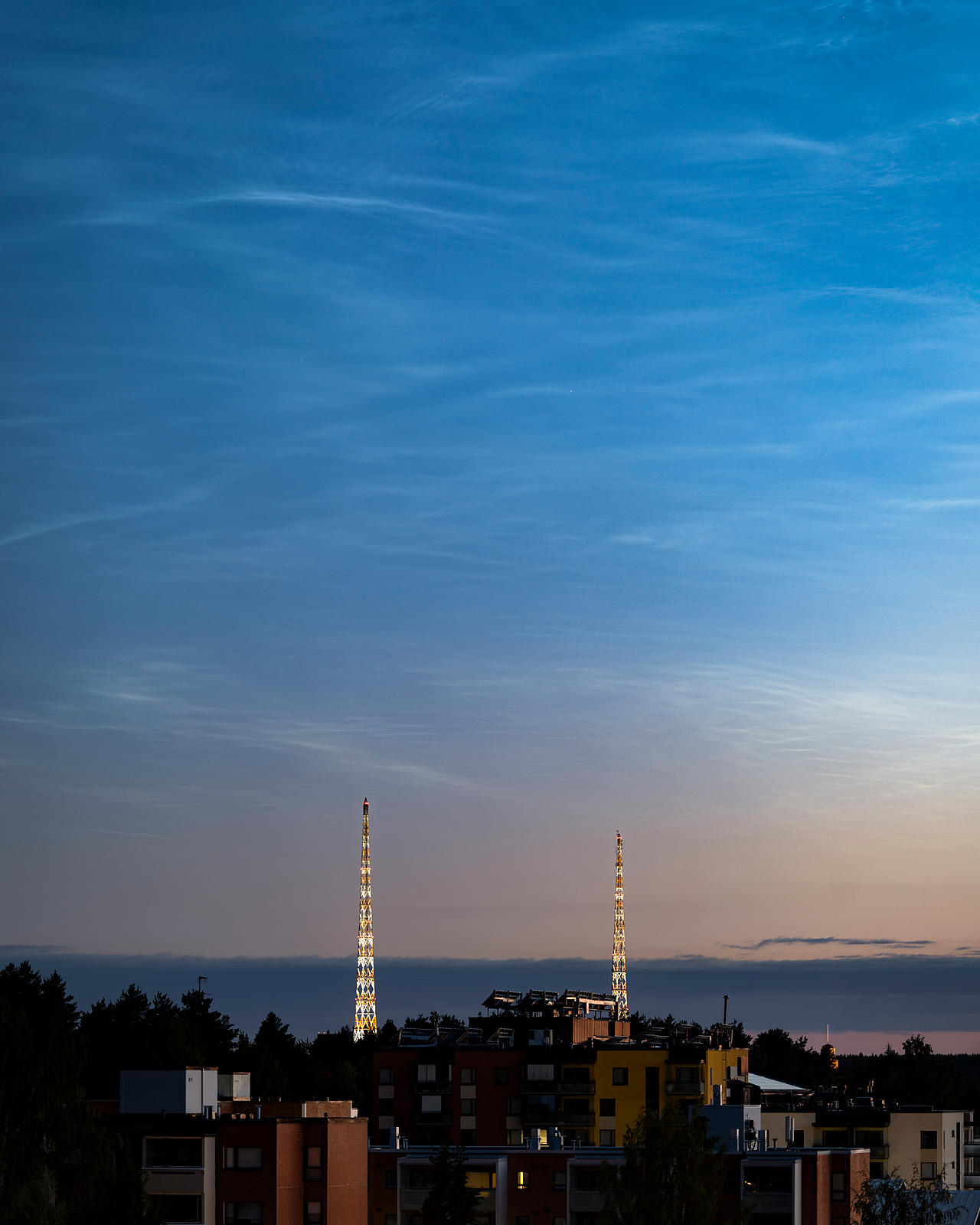 Noctilucent Clouds (NLCs) above the landscape in Lahti, Southern Finland on July 10 2018.