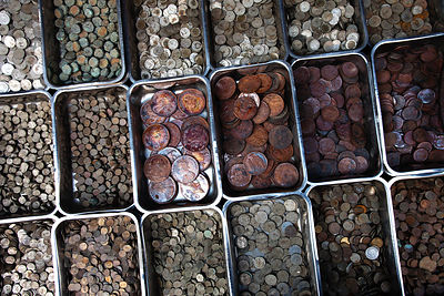 Old coins for sale, likely all fake, in Chor Bazaar, also known as the Thieves Market, Mumbai, India.
