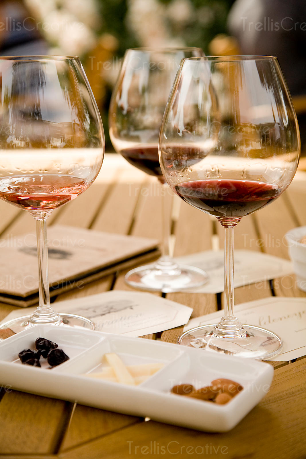 Outdoor wine and food pairing with pinot noir in shiny wine glasses