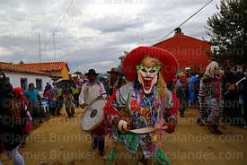 A member of La Caprichosa devil dancers group wearing a Scary Clown mask takes part in parades during Carnival, San Lorenzo,...