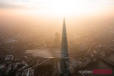 Aerial view of the Shard and its shadow at sunset, London