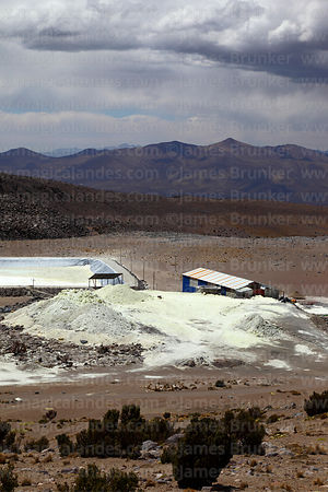 Final evaporation basin (part of the Capurata mining project to extract sulphur) and dried sulphur compounds on flanks of Aco...