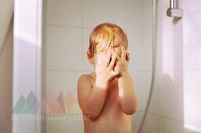 Little boy taking a shower