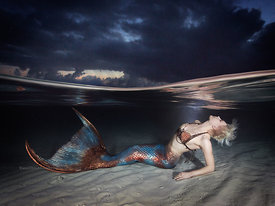 Mermaid Iara Mandyn in under/over photo in shallow water at dusk, Exuma Cays, Bahamas Islands during Mermaid Portfolio Workshop