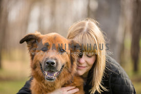 owner hugging dog with eyes closed