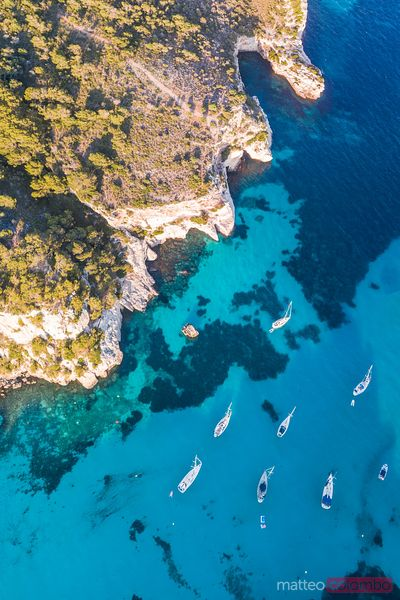 Aerial of bay and yachts, Cala Macarella, Espagne