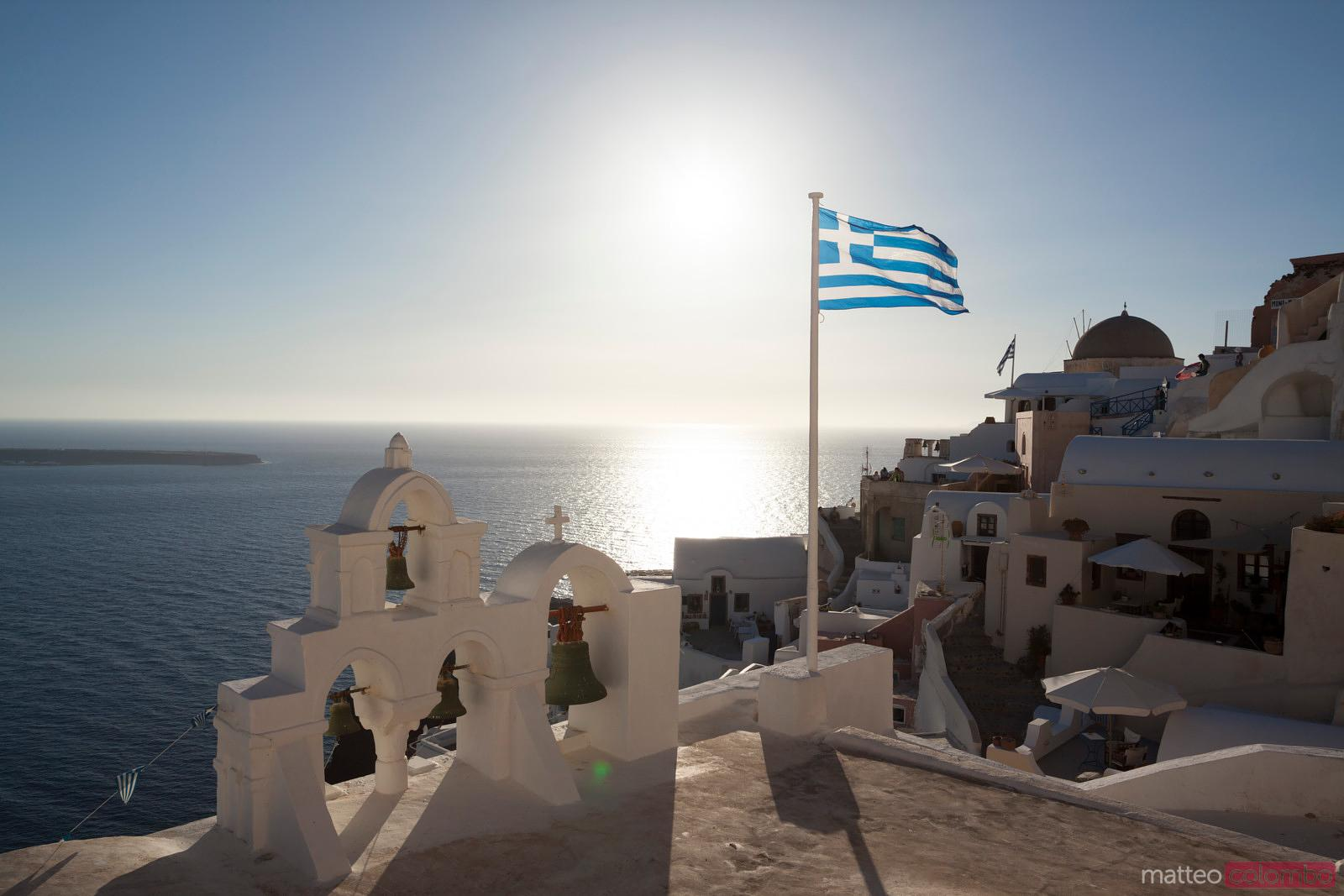 Greece flag waving at sunset