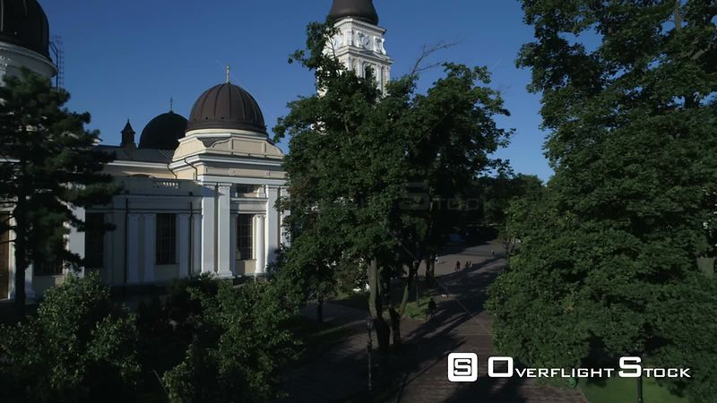 Drone camera flies slowly up from Saborna Square to reveal Preobrazhensky Cathedral in Odessa Ukraine. Taken on a crystal cle...