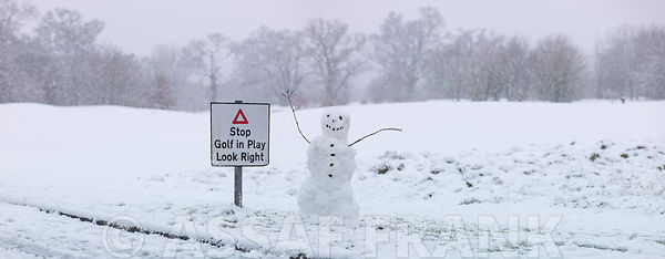 Snowman with stop sign board