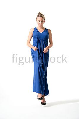 A Figurestock image of a blonde woman in a blue evening dress, walking down some steps - shot from mid level.