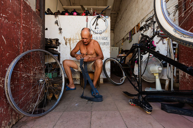Man Repairing a Bicycle Flat