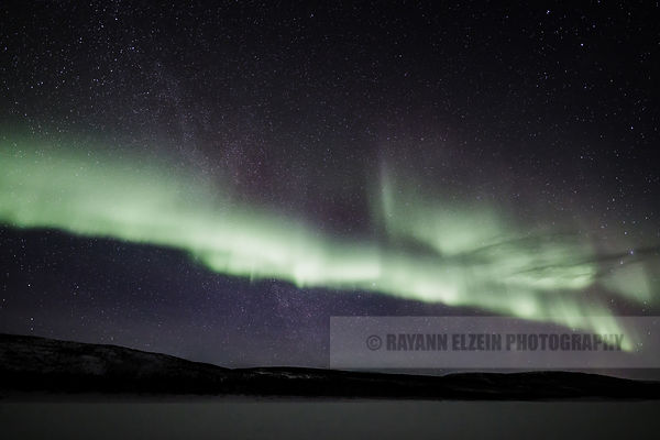 Band of northern lights above the Teno River