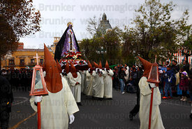 Penitents carrying statue of Virgen de los Dolores / Virgin of Sorrows during Good Friday procession, Plaza Murillo, La Paz, ...