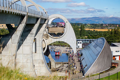The Falkirk Wheel with a boat on board and views across Open Countryside
