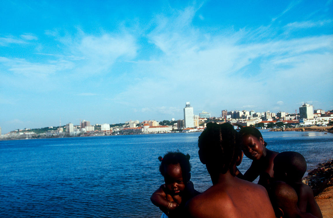 Angola - Luanda - Poor mothers from a nearby slum come to play with their children on the beach