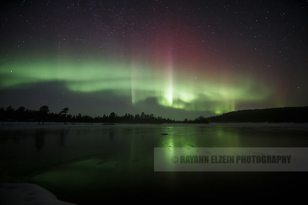 Rare red Aurora at the Kettujoki River near Inari