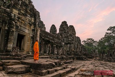 Monk at sunrise inside Angkor Wat temple, Cambodia