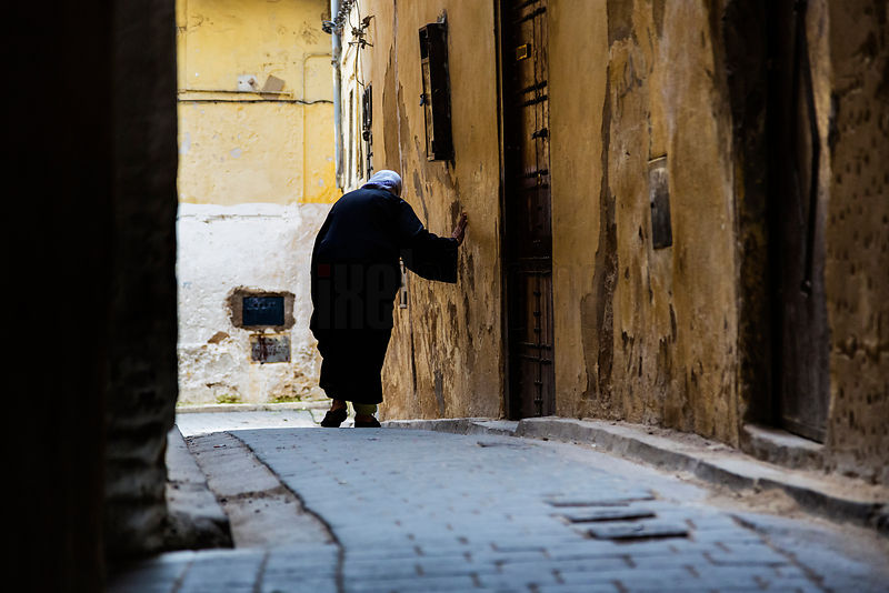 Old Lady Walking In Alleyway
