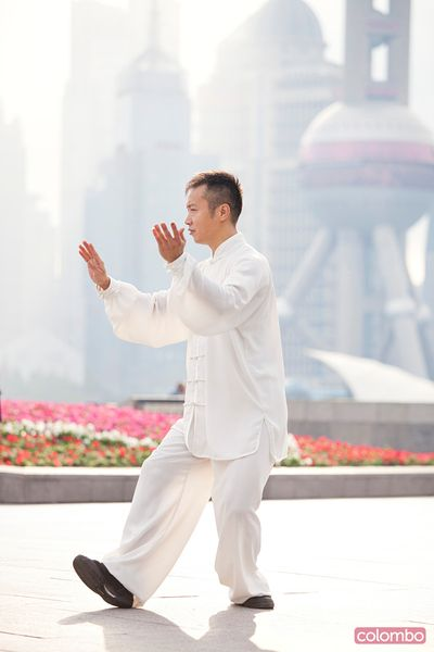 Chinese man practicing Tai chi, Shanghai, China